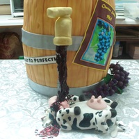 "Drunk Cow The barrel 4 x 4"" by 10"" round cakes. (16+"" tall) I have no idea why a drunk cow at a winery was the selected design."