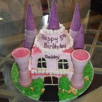 Princess Gabby's Castle Princess birthday cake. White cake, buttercream frosting, royal icing accents