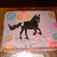 Horse/ Peace Signs chocolate cake b-cream and fondant. dusted in luster dust though it doesn't show up and the colors aren't as vibrant in photo....