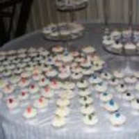 "Cupcake Wedding 500 cupcakes with fondant rosebud that matched each of the colors in the bridal party. Centerpiece: 6"" with full- size roses of each..."