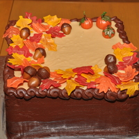 Fall Harvest Cake Cream cheese-caramel buttercream on top and in between layers of chocolate cake, outside frosted with chocolate buttercream. Fondant leaves...