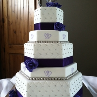 Two Hearts Themed Purple And Silver Hexagon Wedding Cake The photo looks navy blue but the cake was actually deep purple and silver, this was my first time making gumpaste roses, using the...