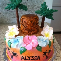 Hawaiian Themed Cake Birthday cake for 11 year old girl having a Hawaiian themed party, tiki is cake, flowers are gumpaste, palm tree's are tootsie rolls...