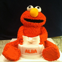 Elmo Cake 3-D Elmo cake for a 2 year old girl, head and body are cake with buttercream piped on with grass tip, arms and legs are RKT, and eyes and...