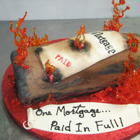 Mortgage Burning  A cake celebrating the last payment of a mortgage. The flames are made from molten isomalt, tinted red and orange and poured over ice. It...