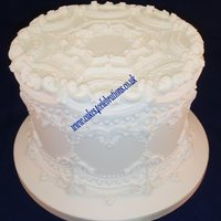 Tradional Style Royal Iced Cake 1910 This 9 inch royal iced cake (6 inch depth) was piped in the style of S.P. Borella - booked published 1910