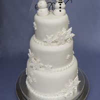Winter Wedding Snowman couple and snowflake wedding cake. 10 inch 8 inch and 6 inch round cakes.