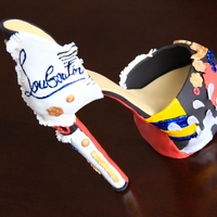 Christian Louboutin Anniversary Shoe Shoe modeled after an anniversary Christian Louboutin shoe. Made entirely out of fondant and gumpaste.