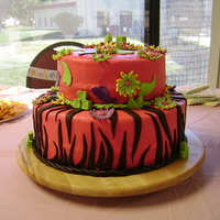 Hot Pink Zebra Non-traditional baby shower cake - the mom-to-be loved it! Chocolate cake covered in hot pink buttercream icing with fondant decorations.