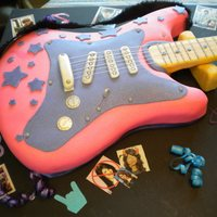 Guitar Cake   Chocolate cake with Buttercreme frosting inside. Outside is MMF and a little creativity..