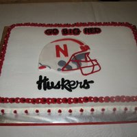 Go Huskers!   Iceed in bc, with fondant helmet.