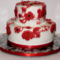 Red, White And Black Practice cake with red candy clay applique flowers and satin ribbon.