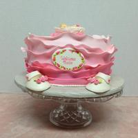 Baby Girl Ruffle Cake This is a MMF ruffle cake topped with a sleeping baby in angel wings, a hand painted plaque to welcome the new arrival, tiny white...