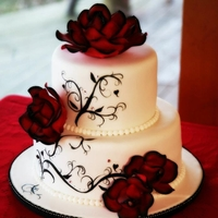 Elegant Rose & Scroll This was created using chocolate cake with a mocha buttercream icing and MMF. Handpainted Scroll work and handmade gum paste roses,...