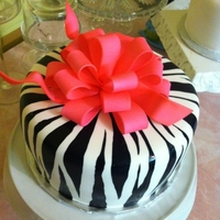 Zebra & Pink Bow A 40th Bday cake, this was created with white cake and MMF, hand painted zebra pattern with a gum paste bow, airbrushed hot pink.
