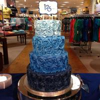 Blue Ombre Rosette Cake Belk's 125th Anniversary Celebration Cake This was created using the store's ombre colors with a handpainted sign.
