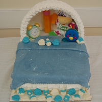Baby Bed Cake Canopy and some of the decorations made of white chocolate