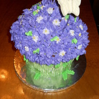 Purple Bouquet Made with Giant Cupcake Pan. Two tone purple flowers. white chocolate butterfly.