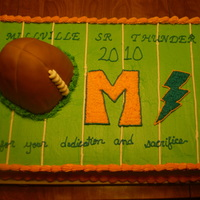 Thunderbolts Football Banquet Sheet cake with a hand carved football exploding out of the turf for a home town teams football banquet. Go Thunderbolts!