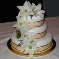 Lily Cake 3 tier chocolate mud cake with fondant icing and fresh lillies to finish