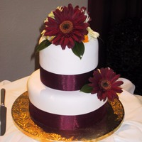 Gerbera Cake 3 tier fruit cake with fondant icing and fresh gerbera flowers