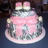Zebra Themed Baby Shower Top layer is chocolate cake with chocolate fudge filling and frosting. Bottom is white cake with buttercream filling and frosting. Cake is...