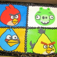 Angry Bird Cake  This is a 2 layer 9x13 chocolate sheet cake. I cut the angry birds out from fondant. I used the cut outs from the angry bird gummy box for...