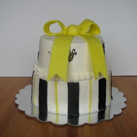 "Bees And Bows 8"" and 6"" cakes covered in BC. The bow and stripes are fondant and the bees are RI."