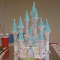 Castle Cake Romantic Castle KIt from Wilton. Turrets are covered in icing and edible glitter... lots of edible glitter! Cakes were covered in...