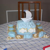 Boy's 1St Birthday Cake Sailboat is made of paper, everything else is edible. Fish on the cake and letters are cookies. Cake done in July 2003.