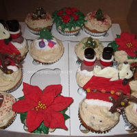 Christmas Cupcakes, Decorations Of Chocolate, Fondant, And Buttercream. Christmas cupcakes, decorations of chocolate, fondant, and buttercream.