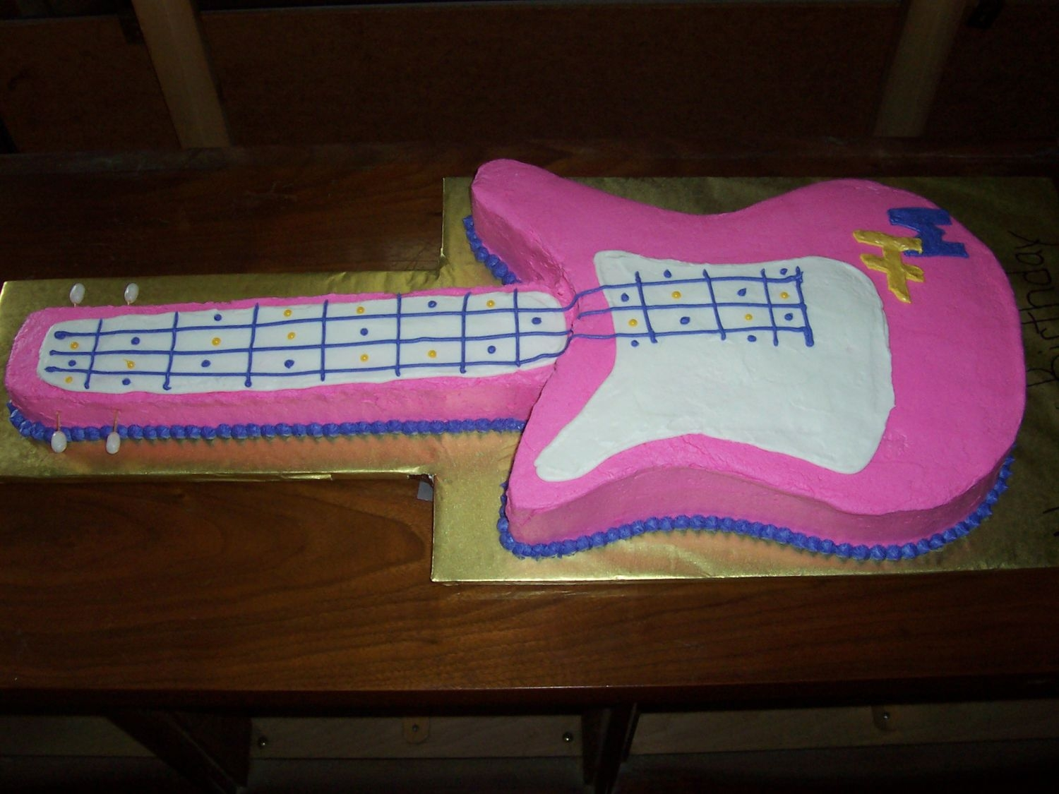 Hannah Montant Guitar Cake The cake is french vanilla w/Indydebi's buttercream icing. The very end of the neck it RKT. The tuning knobs are french vanilla jelly...