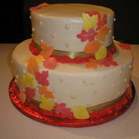 Fall Wedding buttercream frosting with white chocolate paste leaves brushed with gold glitter dust