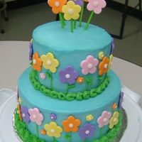 Heather's Cake Wilton inspired, two tier flower cake. Iced in BC and used fondant flower cut-outs.