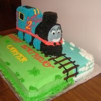 Thomas The Train This is a birthday cake for my train crazy nephew Carter. 3D train is banana cake for ensure firmness. All iced in BC