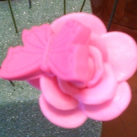 Sugar Gumpaste Butterfly On A Rose I put a Butterfly on top of a Rose to see how it would look. just playing with look. they are made of sugar gumpaste
