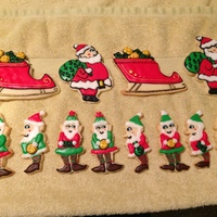 Santa's Cash Christmas I made these for a cookie order I had. The sleigh is filled with money and gold coins. The elf's are hold gold coins, money and money...