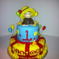 Curious George Cake Inspired from a lot of pics here on cake central. Curious George made in fondant.