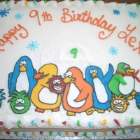 Club Penguin iced with buttercream, filled with oreo filling, yellow cake!!!