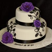 Purple Fantasy Two tier white choc mud and caramel mud. Covered in fondant. Handmade decorations.