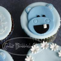 Baby Hippo Cupcakes A combination of vanilla, chocolate and red velvet cupcakes filled with vanilla, chocolate and cream cheese frosting. Fondant accents.