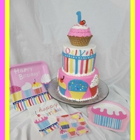 Cupcake 1St Birthday! Cake was designed to match the party ware. What could possibly be better than pink and cupcakes?