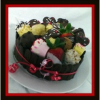 Valentine's Day Gift Basket single layer chocolate cake filled with strawberry filling, iced in vanilla buttercream, surrounded by chocolate panels and topped with...