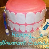 Teeth! This was a retirement cake for a dentist's only asststant he had ever had ~ she had actually been at the practice longer than he had....