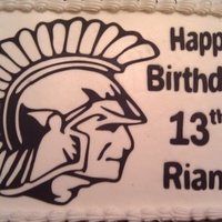 Spartan Birthday Cake Spartan theme birthday cake. Spartan image was cut using SCAL2 and the Cricut Expression. Vanilla cake with white chocolate buttercream...