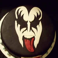 "Gene Simmons ""kiss"" Birthday Cake  This is for a friend who is a Gene Simmons fan. Gene Simmons is on top. The word ""KISS"" is on the side and a spiked collar is at..."