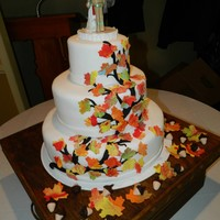 Autumn Leaves Wedding Cake   Autumn Leaves with acorns Wedding Cake. Bride and groom are a nurse and fireman. The cake stand was made by the groom's father.