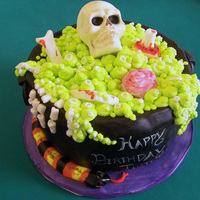 Spooky Cauldron Cake is based on a Cakegirls design. I used a wilton mold for the skull, all other details were hand-molded.