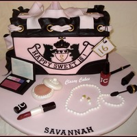 "Savannah The 10"" Purse is French Vanilla cake with chocolate mocha filling. All the makeup was done with gum paste. So girly and fun!! I cut..."