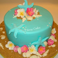 Tiffany Seashore Gum paste Frangipanis, chocolate shells and fondant starfish. Vanilla cake with ganache filling.